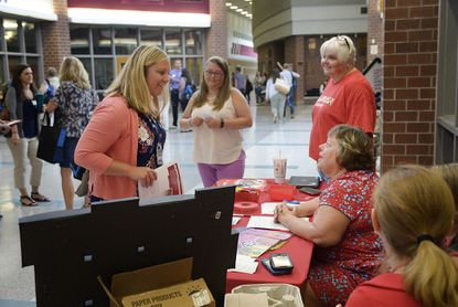 Amanda Stone, left, who is an incoming second grade teacher at Friendship Valley Elementary School, talks to Teresa McCulloh of the Carroll County Education Association during new teacher orientation for Carroll County Public Schools at Winters Mill High School in Westminster Thursday, August 15, 2019.