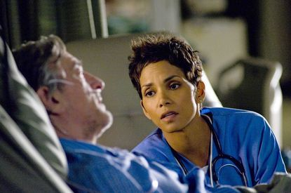 """Robert De Niro as Stan and Halle Berry as Aimee hope to see in one more new year together in New Line Cinema's """"New Year's Eve,"""" now playing at area theaters."""