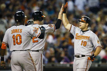 Chris Davis receives congratulations from Matt Wieters and Adam Jones after hitting a three-run homer during the seventh inning Saturday night in Detroit.