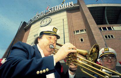 Antonio D'Eugenio plays Dixieland music in front of Memorial Stadium in April of 1990. The stadium was demolished in 2002. (Ken Koons/Baltimore Sun).
