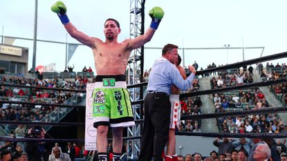 Danny Garcia celebrates after knocking out Adrian Granados in the seventh round.