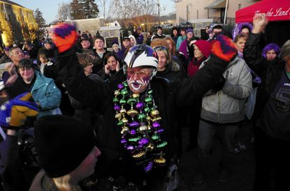 "Matt ""Fan Man"" Andrews gets the crowd pumped up as he and fellow Bus Boy ""Ravin Rick"" Dixon arrive for the Ravens Rally held in January in Bel Air's Armory Park, one of several rallies around the county during the month as the Ravens made their successful Super Bowl run."