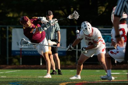 Hereford's Jason Bowen (7) fires a shot for a goal past the head of Glenelg's Cam Sedlack (4) during the MPSSAA Class 2A Boys Lacrosse semifinals on Wednesday, June 16, 2021.