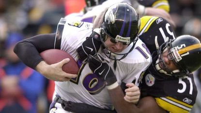 The Ravens' Elvis Grbac is sacked by Steelers linebacker Mike Jones in the first quarter of Pittsburgh's 27-10 win in a divisional-round playoff game Jan. 20, 2002. Grbac was 18-for-37 for 153 yards and a quarterback rating of 26.1.