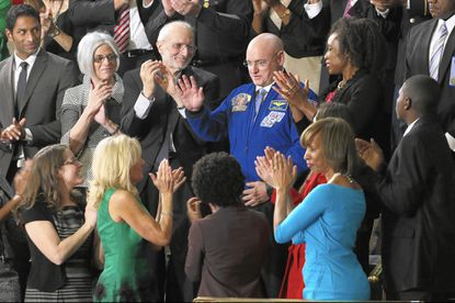 Astronaut Scott Kelly is applauded during President Obama's State of the Union address. Maryland State Sen. Catherine Pugh is on the right wearing a blue dress.
