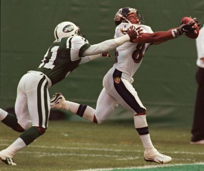 Ravens reciever Jermaine Lewis makes a touchdown catch over New York Jets cornerback Aaron Glenn during an exhibition game at Giants Stadium in 1998.