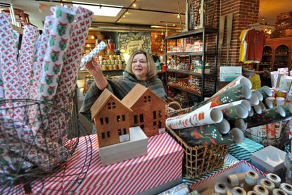 Baltimore, MD -11/20/14 - Debbie Anzalone of Rodgers Forge browses in November 2014 at the wrapping paper display at Trohv, a Hampden shop. Amy Davis / Baltimore Sun - #6070