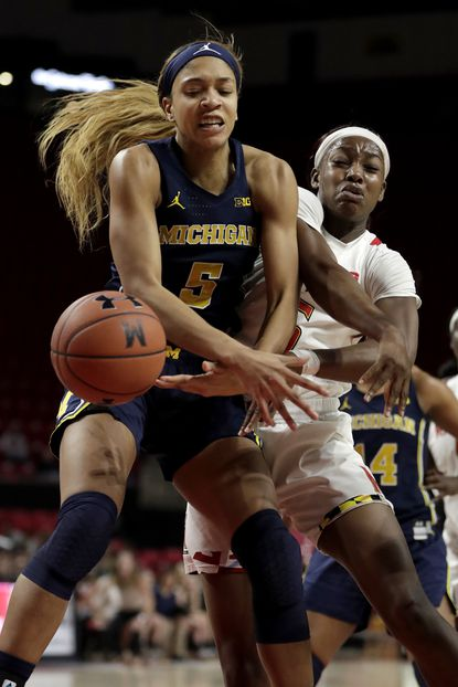 Michigan forward Kayla Robbins, left, and Maryland guard Kaila Charles compete for a rebound during the second half of an NCAA college basketball game, Saturday, Dec. 28, 2019, in College Park, Md. (AP Photo/Julio Cortez)