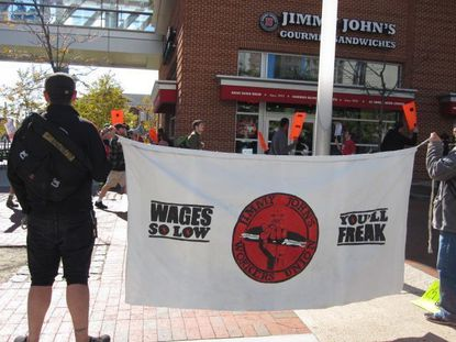 "Workers and organizers picketed outside the downtown Jimmy John's before a recent Ravens game. ""Ravens have a union!"" the protesters chanted. ""Why can't we?"""