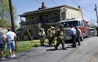 Fire crews respond to a basement fire in an apartment building in the unit block of York Street in Taneytown Monday, April 18, 2016.