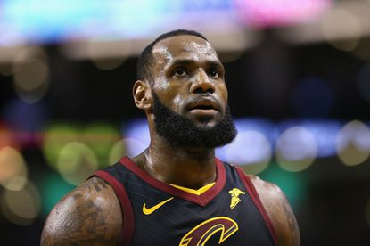LeBron James of the Cleveland Cavaliers looks on in the first half against the Boston Celtics during Game Seven of the 2018 NBA Eastern Conference Finals Sunday night.