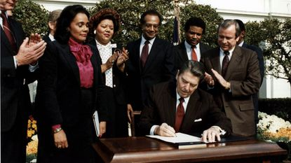 On Nov. 2, 1983 President Ronald Reagan signed Public Law 98-144 commemorating Martin Luther King Jr.'s birthday as a national holiday, in the White House rose garden with Coretta Scott King.
