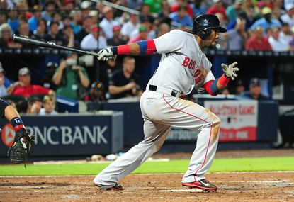 Alejandro De Aza #31 of the Boston Red Sox knocks in a sixth inning run with a double against the Atlanta Braves at Turner Field on June 18, 2015 in Atlanta, Georgia.
