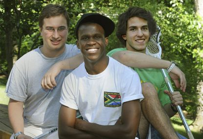 From left to right, Kip Hart, Phinius Sebatsane and Harrison Hart are pictured. The Hart brothers and their mother, Barb Cox, started the South African Lacrosse Project in 2007 to introduce lacrosse to the children in that country. Sebatsane was in the first group.