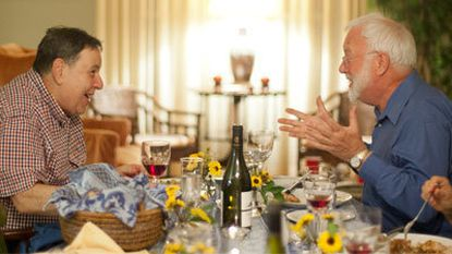 George Rothstein, of Columbia, at left, shares a story about Julia Child with Sandy Sharp during a dinner hosted by the Columbia Foodies.