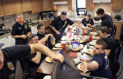 Members of the Anne Arundel County Fire Department's 26th Fire Company, in Glen Burnie, gather for a brunch meal on Thanksgiving. Firefighters, medics and drivers reflected on the past six months of working on the front lines of the coronavirus pandemic.