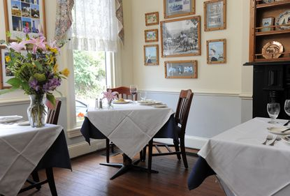 The cozy and romantic dining rooms at Tersiguel's are decorated with art and artifacts from the owners' native Brittany.
