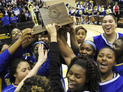 The Aberdeen girls basketball team celebrates their victory over River Hill to take the 2012 Class 3A state championship at UMBC.