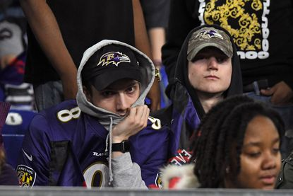 Ravens fans look dejected as the Baltimore NFL franchise loses to the Tennessee Titans in the Divisional Playoff at M&T Bank Stadium.