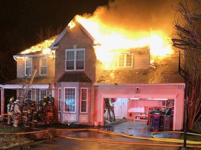 Firefighters battled a house fire in the 800 block of Caren Drive early Wednesday morning. Two residents and their dog escaped, according to the fire chief.
