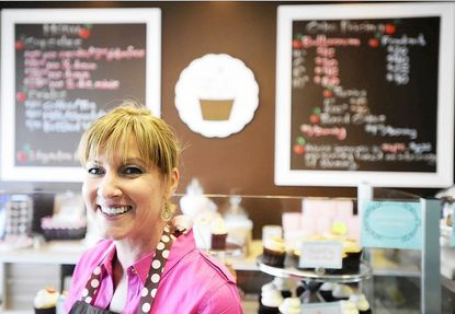 "Shelley Stannard, who appeared on Food Network's ""Cupcake Wars"" and won, at Flavor Cupcakery in Cockeysville."