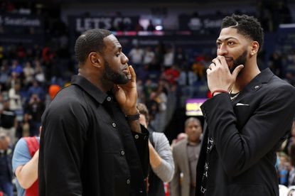 Lakers forward LeBron James, left, and Anthony Davis, then forward-center for the Pelicans, chat after a game March 31.