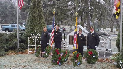 The American Legion Post #39 Color Guard stands behind the seven memorial wreaths placed at the Bel Air War Memorial in December 2016 as part of the nationwide Wreaths Across America observance. The post is again participating in the program to honor deceased veterans.