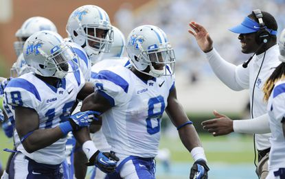 Middle Tennessee cornerback Sammy Seamster (8) celebrates after intercepting a pass against the North Carolina Tar Heels at Kenan Memorial Stadium.