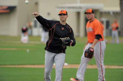 Baltimore Orioles pitcher Oliver Drake, left, throws in front of Tommy Hunter during spring training at the Orioles training facility, Friday, Feb 27, 2015.