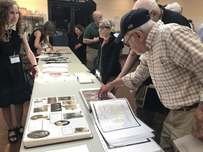 Friends and family from a single Russian village named Mlynov immigrated to Baltimore a century ago. On Saturday their descendants gathered here to learn more about their shared immigrant history.