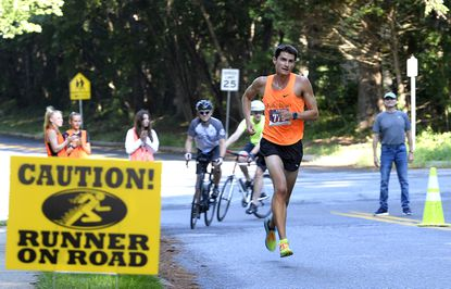 Graham Peck of Baltimore, who won the men's race, runs along Ronsdale Road in the Eldersburg Rogue Runners Labor Day Rogue Race Monday, Sept. 6, 2021.