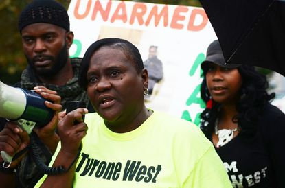 At last night's rally protesting the deaths of Tyrone West and Mike Brown, a call for police accountability