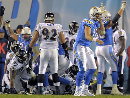 San Diego Chargers quarterback Philip Rivers, right, looks at the sideline after his team scored a touchdown against the Ravens in 2011.