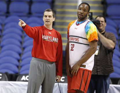 Terps coach Mark Turgeon talks with Dez Wells during the team's open practice Wednesday at the Greensboro Coliseum.