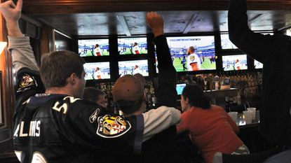 Ravens fans cheer during a 2010 playoff victory against the New England Patriots while watching at Looney's Pub in Canton. A new Looney's Pub will open in Perry Hall next week.