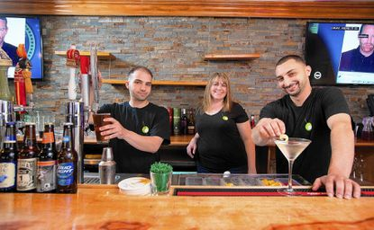 Olive on Main owners Nadol Hishmeh, right, his wife, Amanda, and brother Chris Hishmeh, left. The new Main Street restaurant and bar serves American and Mediterranean cuisine.