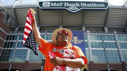 A local street vendor sells American flags before the 2015 CONCACAF Gold Cup quarterfinal between Cuba and the United States at M&T Bank Stadium.