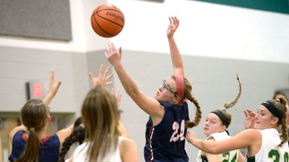 FSK's Rachel Wright, left, and Emily Dell reach for a rebound during the second half of the Eagles' 53-35 win over the Knights in Eldersburg Monday, Dec. 18, 2017.