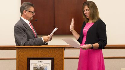 Mount Airy Mayor Pat Rockinberg (Left) swears in recently-elected Councilwoman Patty Washabaugh minutes before Mayor and Council's monthly meeting Monday, Oct. 1. Washabaugh won the towns first special election Sept. 10.