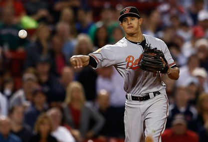 Orioles third baseman Manny Machado was edged by Red Sox second baseman Dustin Pedroia for the Wilson Defensive Player of the Year in the American League.