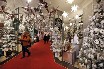 In this Tuesday, Nov. 5, 2019, photo, shoppers browse the Holiday Lane section at the Macy's flagship store, in New York. With three weeks until the official start of the holiday shopping season, the nation's retailers are gearing up for what will be another competitive shopping period.