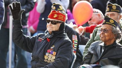 Retired Marine Corps Col. Lou Schott, 98, and Vivian Bailey, 101, who served in the Women's Army Corps, both served during World War II. They are seen in the 2017 Ellicott City Veterans Day parade.