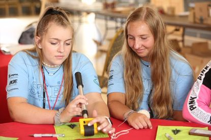 Terra Miley, left, from Frances Scott Key High School, Claire Kettula, from South Carroll High School, participated in Exelon's HeForShe STEM Innovation Leadership Academy. STEM programs aimed at girls are being challenged as discriminatory.
