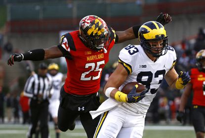 Michigan tight end Zach Gentry, right, gets past Maryland defensive back Antoine Brooks Jr. for a touchdown in the first half Saturday at Maryland Stadium.