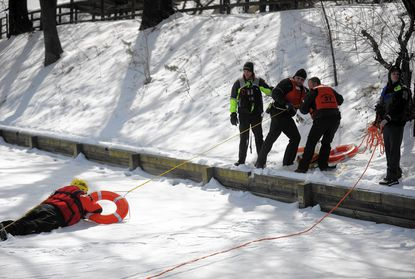 First responders from the English Consul and Lansdowne volunteer fire departments joined other Baltimore County companies to practice techniques during an ice and water rescue training seminar in January at Hillcrest Park.