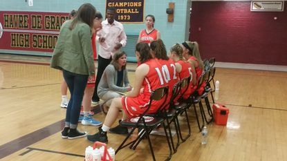 Fallston coach Renee Badger talks with her team during a timeout of Thursday's game in Havre de Grace. The Cougars win was the first for Badger, who took over the girls basketball program this season.