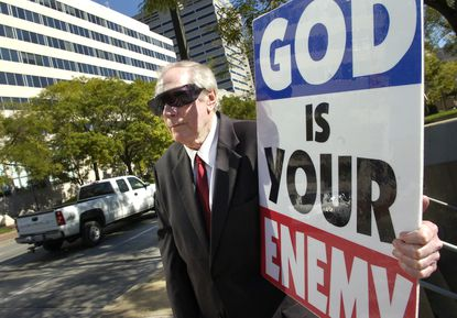 Westboro Baptist Church founder Fred Phelps, seen here demonstrating across the street from the U.S. District Court in Baltimore, died Thursday at 84.