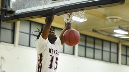 Havre de Grace's Marlon Lewis, shown here with a dunk, scored 26 points Friday night, but the Warriors were beaten by Crisfield, 72-66.