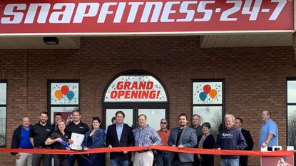 Local politicians and business representativeshelped owners Heather and Scott Rockhill cut the ribbon for Snap Fitness, the latest addition to the Crossroads Station Shopping Center in Upper Cross Roads, on March 5.