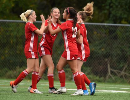 Juliana Carriera (10) celebrates a first half score with Concordia teammates, from left, Madison Hieber, Paige Bailey and Phoebe Bannan against Pallotti during an IAAM girls soccer match at Concordia Prep on Thursday, September 5.